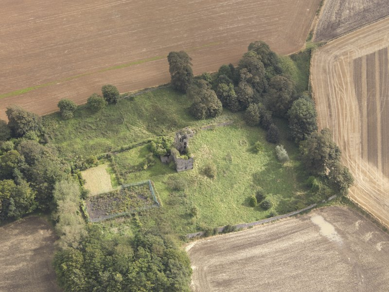 Oblique aerial view of Piteadie Castle, looking to the ENE.