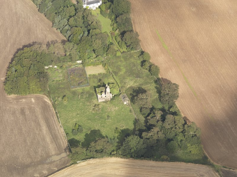Oblique aerial view of Piteadie Castle, looking to the NNW.