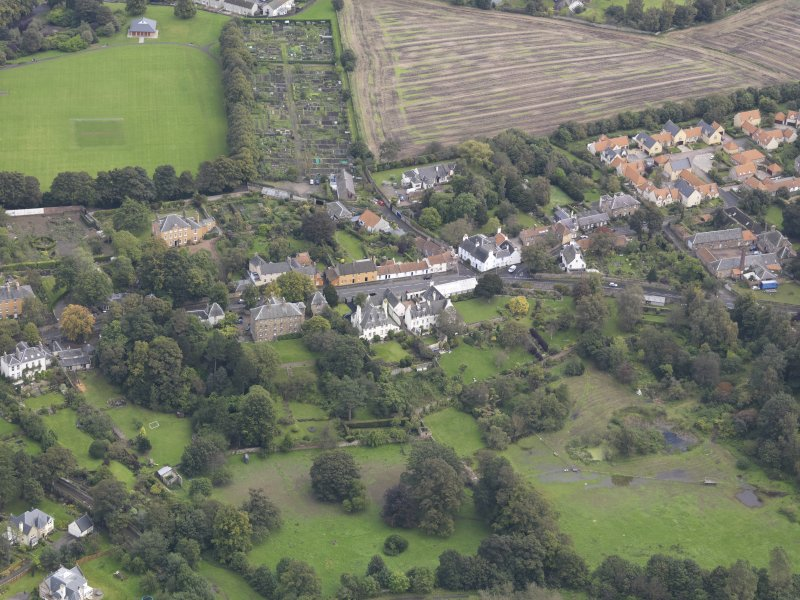 General oblique aerial view of Inveresk Village Road centred on the Manor House, looking to the NE.