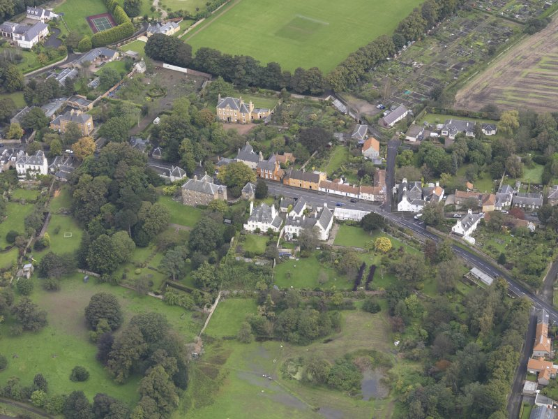 General oblique aerial view of Inveresk Village Road centred on the Manor House, looking to the NNE.