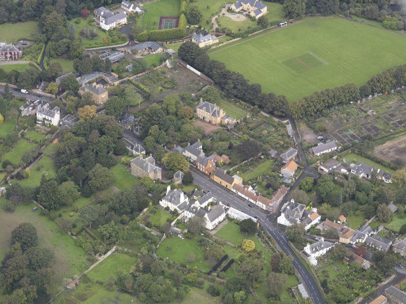 General oblique aerial view of Inveresk Village Road centred on the Manor House, looking to the N.
