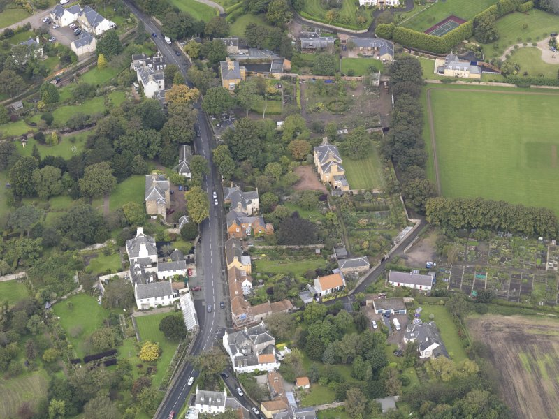 General oblique aerial view of Inveresk Village Road centred on the Manor House, looking to the NW.
