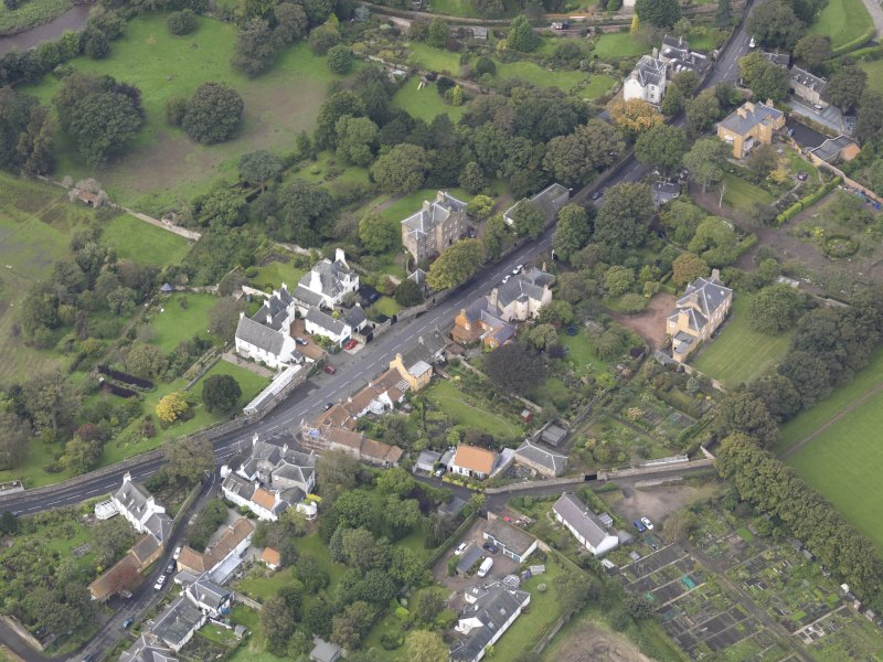 General oblique aerial view of Inveresk Village Road centred on the Manor House, looking to the WNW.