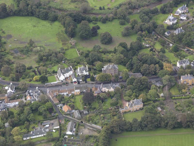 General oblique aerial view of Inveresk Village Road centred on the Manor House, looking to the SW.
