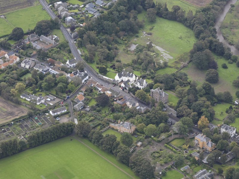 General oblique aerial view of Inveresk Village Road centred on the Manor House, looking to the S.
