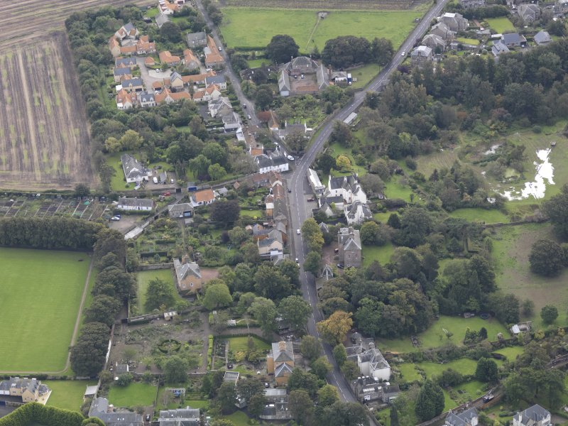 General oblique aerial view of Inveresk Village Road centred on the Manor House, looking to the SSE.