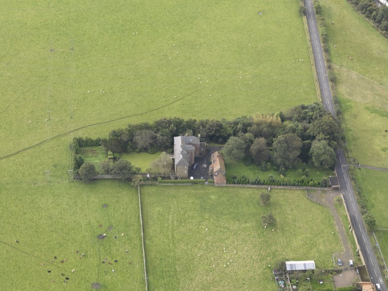 General oblique aerial view of Monkton House with adjacent stable, looking to the WSW.
