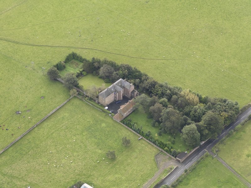 General oblique aerial view of Monkton House with adjacent stable, looking to the S.