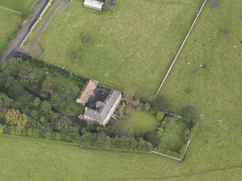 General oblique aerial view of Monkton House with adjacent stable, looking to the NNE.