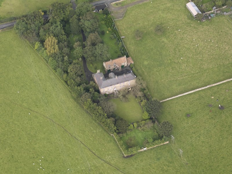 General oblique aerial view of Monkton House with adjacent stable, looking to the NW.