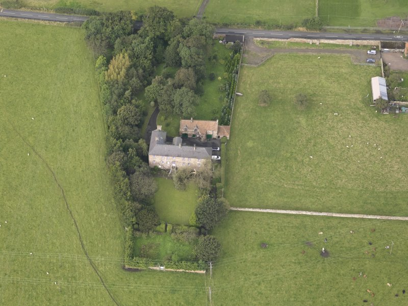 General oblique aerial view of Monkton House with adjacent stable, looking to the WNW.