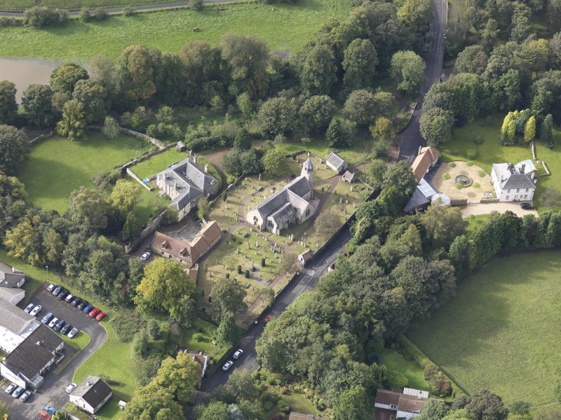 Oblique aerial view of Pencaitland Parish Church, looking to the SW.