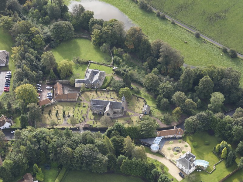 Oblique aerial view of Pencaitland Parish Church, looking to the S.