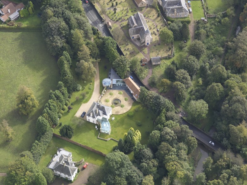 General oblique aerial view of Pencaitland Parish Church with Pencaitland House adjacent, looking to the ESE.