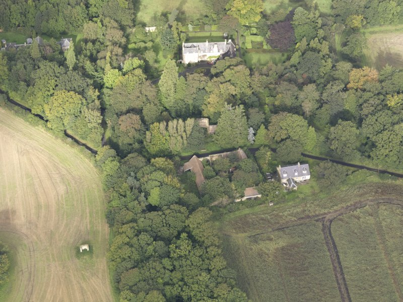 General oblique aerial view of Fountainhall Country House with adjacent dovecot, looking to the NW.