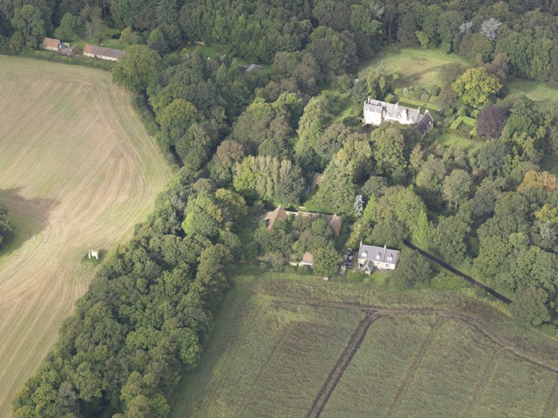 General oblique aerial view of Fountainhall Country House with adjacent dovecot, looking to the WNW.