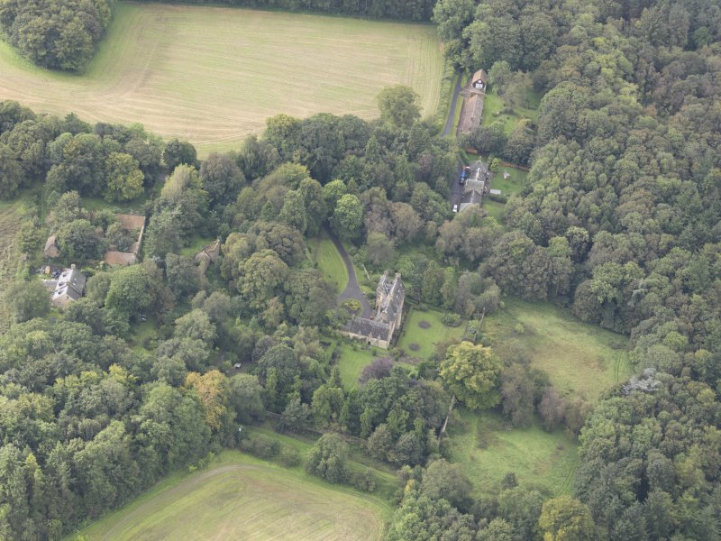 General oblique aerial view of Fountainhall Country House with adjacent stables, looking to the SW.