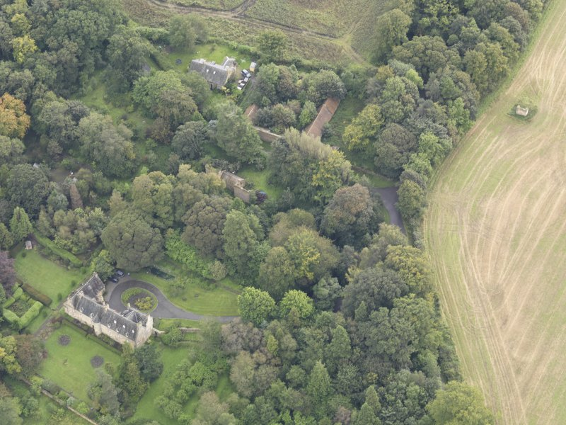 General oblique aerial view of Fountainhall Country House with adjacent dovecot, looking to the E.