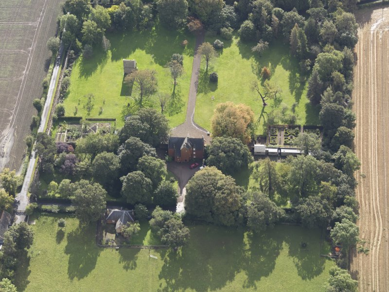 General oblique aerial view of Pilmuir House with adjacent dovecot, looking to the SSE.