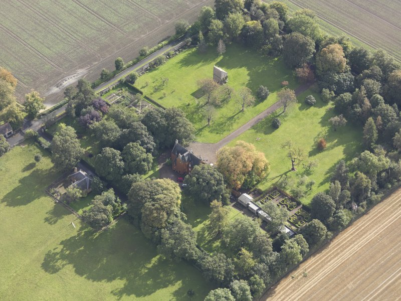 General oblique aerial view of Pilmuir House with adjacent dovecot, looking to the SE.