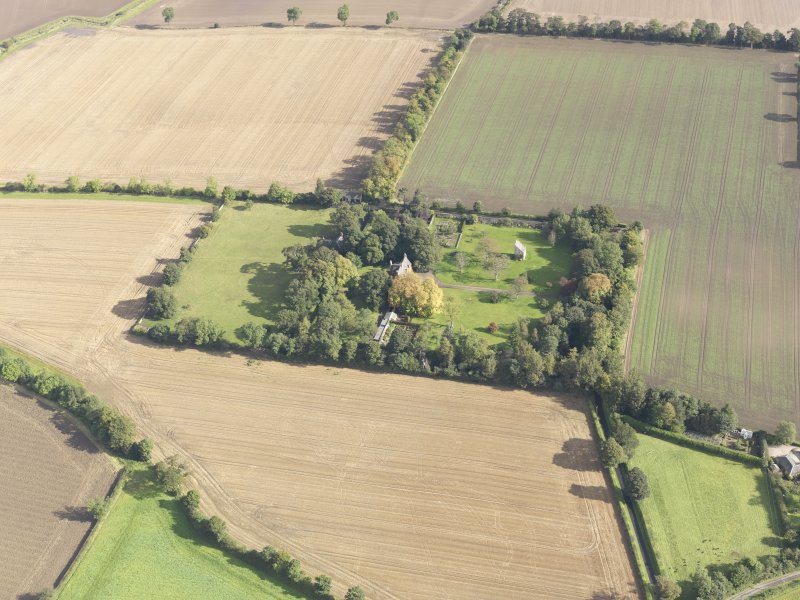 General oblique aerial view of Pilmuir House with adjacent dovecot, looking to the NE.