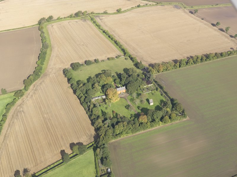 General oblique aerial view of Pilmuir House with adjacent dovecot, looking to the N.