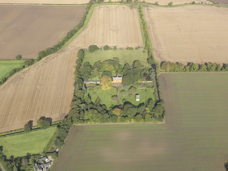 General oblique aerial view of Pilmuir House with adjacent dovecot, looking to the NNW.
