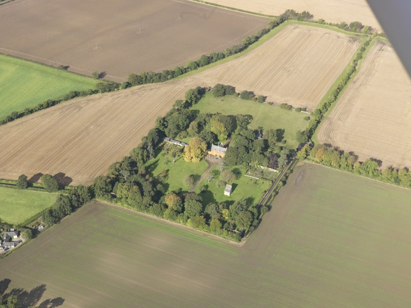 General oblique aerial view of Pilmuir House with adjacent dovecot, looking to the NW.
