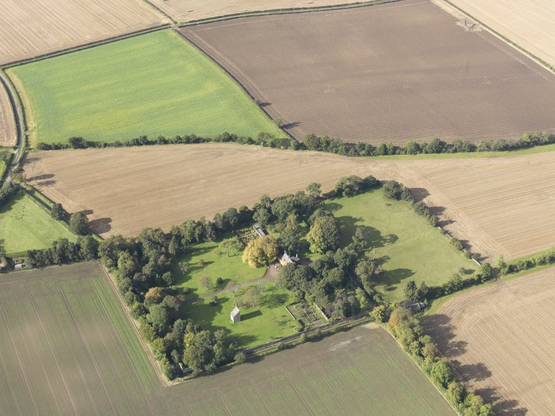General oblique aerial view of Pilmuir House with adjacent dovecot, looking to the W.