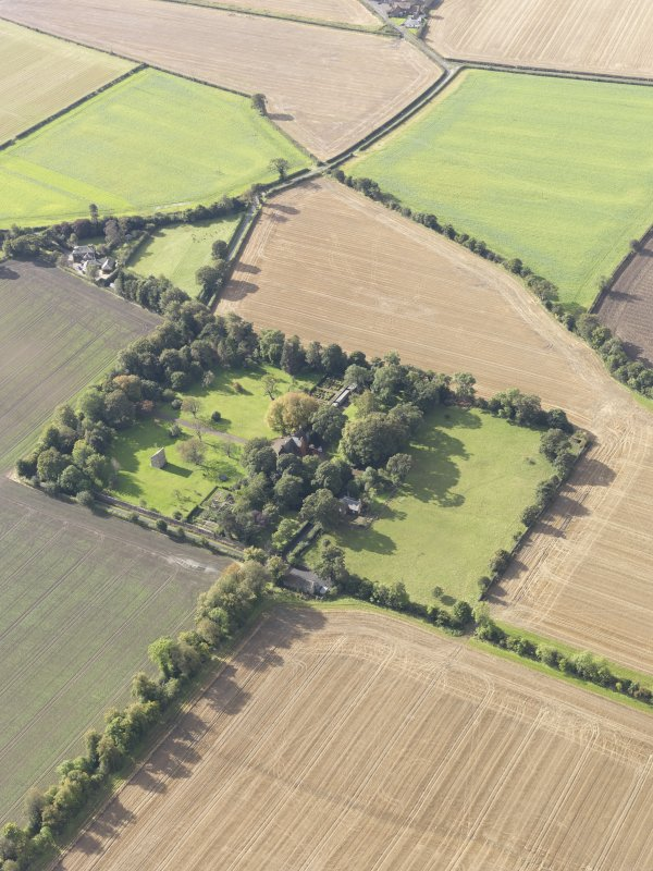 General oblique aerial view of Pilmuir House with adjacent dovecot, looking to the SW.