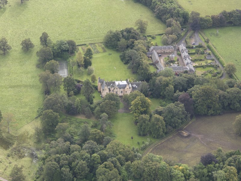 General oblique aerial view of Keith Marischal Country House with adjacent stables, looking to the SSE.