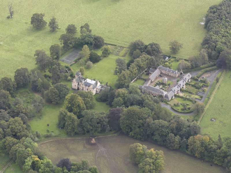 General oblique aerial view of Keith Marischal Country House with adjacent stables, looking to the ESE.