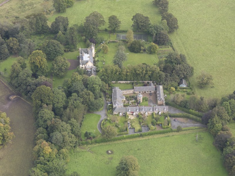 General oblique aerial view of Keith Marischal Country House with adjacent stables, looking to the NE.