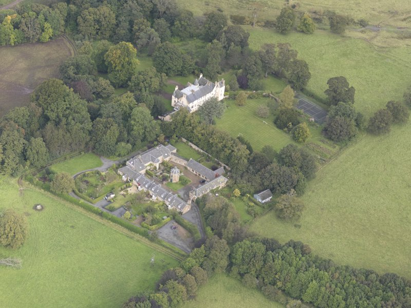 General oblique aerial view of Keith Marischal Country House with adjacent stables, looking to the N.