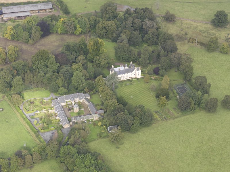 General oblique aerial view of Keith Marischal Country House with adjacent stables, looking to the NNW.