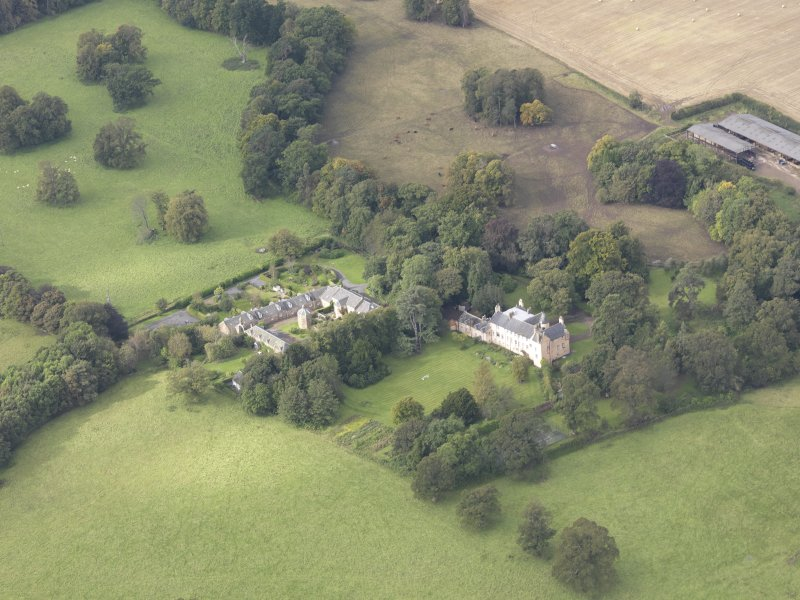 General oblique aerial view of Keith Marischal Country House with adjacent stables, looking to the W.