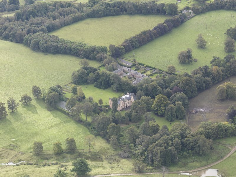 General oblique aerial view of Keith Marischal Country House with adjacent stables, looking to the S.