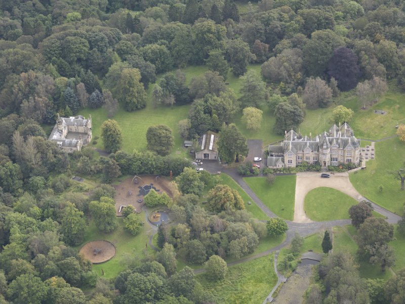 General oblique aerial view of Vogrie House with adjacent stables, looking to the SSE.