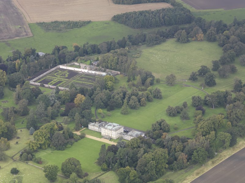 General oblique aerial view of Preston Hall with adjacent walled garden, looking to the NNW.