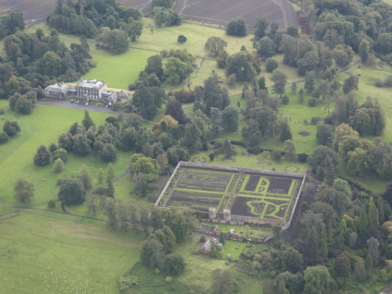 General oblique aerial view of Preston Hall with adjacent walled garden, looking to the SSE.