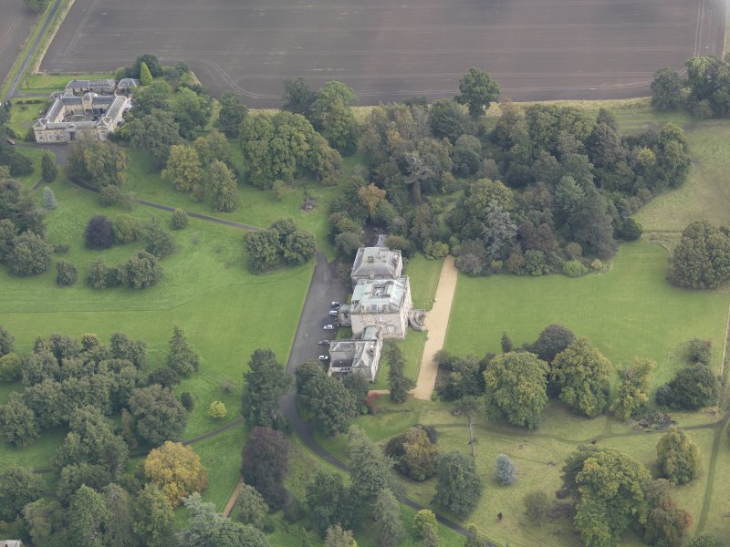 General oblique aerial view of Preston Hall with adjacent stables, looking to the E.