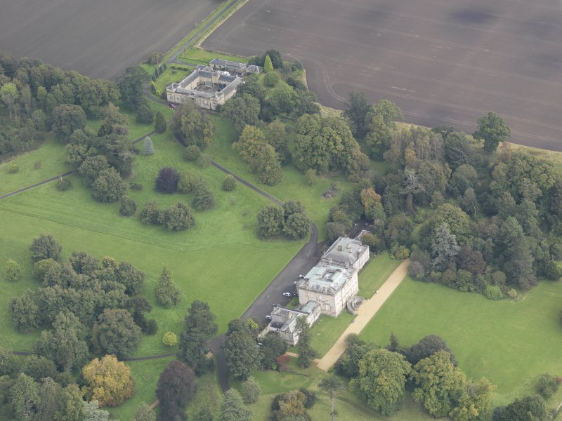 General oblique aerial view of Preston Hall with adjacent stables, looking to the NE.