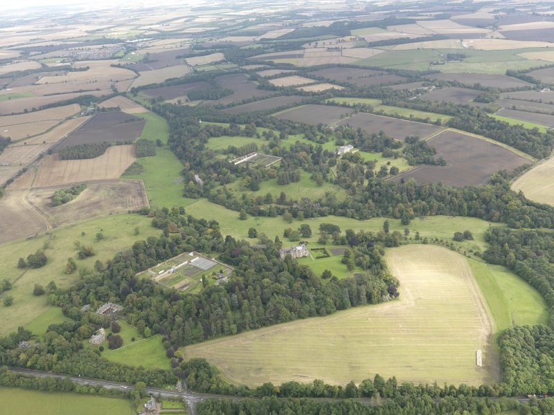 General oblique aerial view of Oxenfoord Castle and Preston House, looking to the NE.