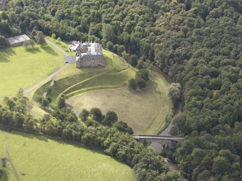 General oblique aerial view of Dalkeith House with adajacent Montague Bridge, looking to the SSW.