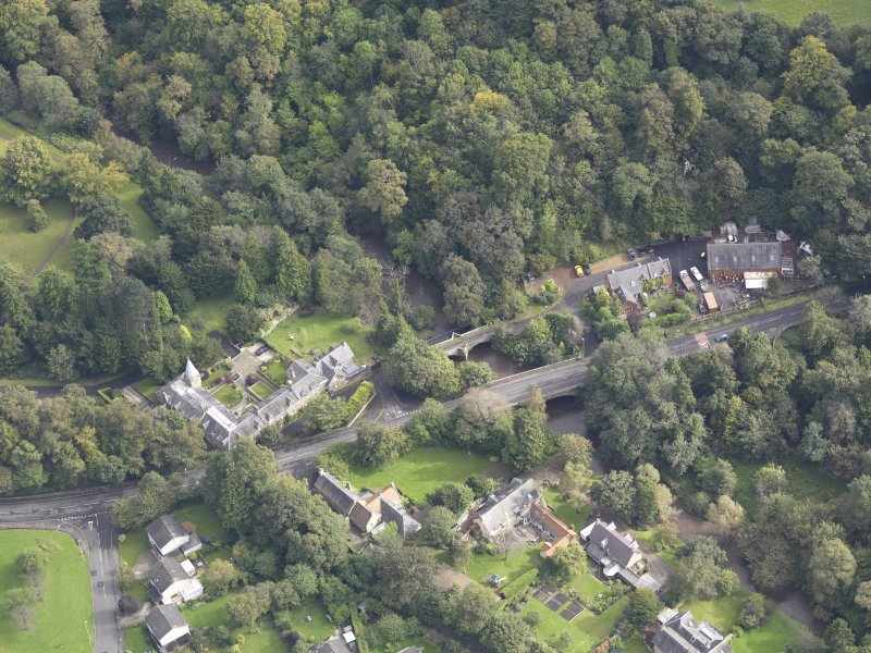 Oblique aerial view of Newbattle Old Bridge, looking to the E.