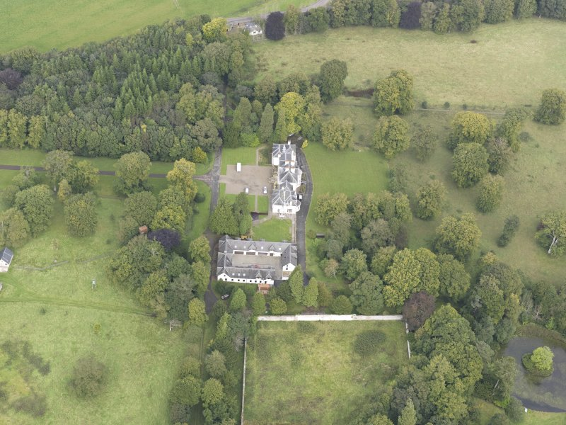 General oblique aerial view of Middleton Hall with adjacent stables, looking to the N.