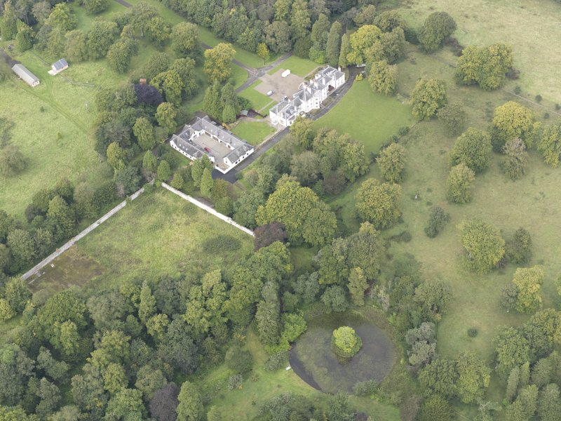 General oblique aerial view of Middleton Hall with adjacent stables and walled garden, looking to the NW.