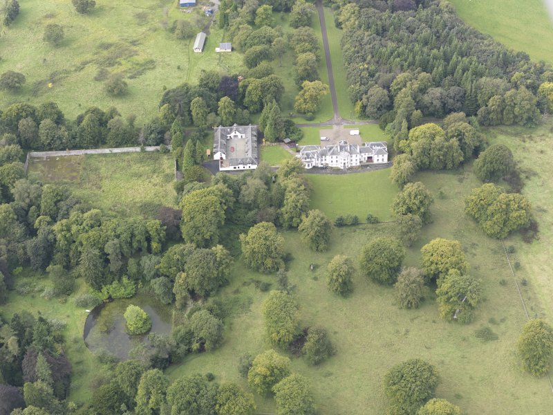 General oblique aerial view of Middleton Hall with adjacent stables and walled garden, looking to the W.
