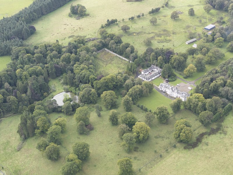 General oblique aerial view of Middleton Hall with adjacent stables and walled garden, looking to the SW.