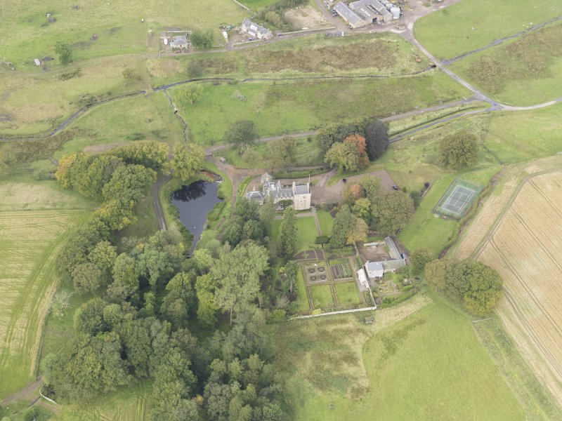 Oblique aerial view of Cakemuir Castle, looking to the NW.
